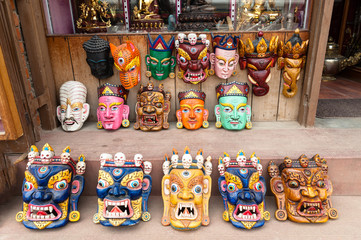 Buddhist festival masks on a shop window in Kathmandu Nepal