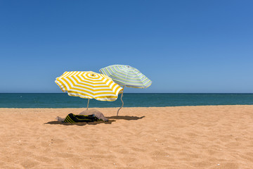 Colorful beach umbrellas on the sandy beach