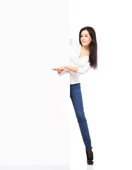 Young sexy woman in denim jeans holding a blank banner isolated