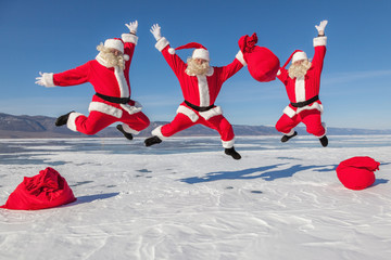 Three Jumping Santa Claus outdoors