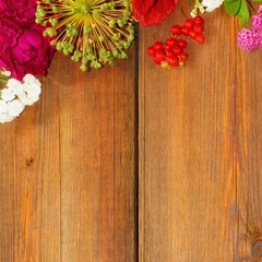 Flowers and Fruits on Grunge Wooden board