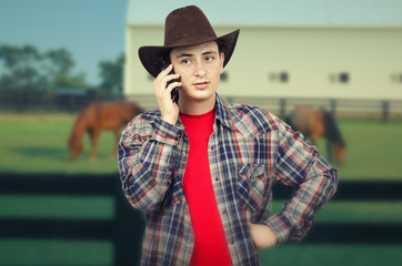 Portrait of cowboy listening to someone on the phone