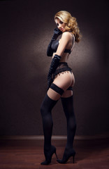 Young and beautiful cabaret dancer in sexy vintage lingerie