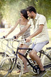 couple having fun by bike on holiday to the lake in Italy