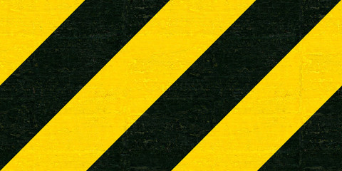 Warning black and yellow hazard stripes texture