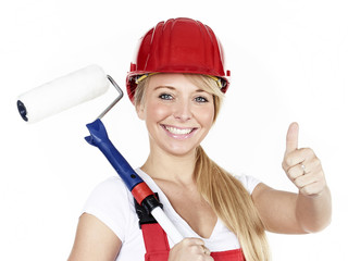 Apprentice with paint roller shows thumb up
