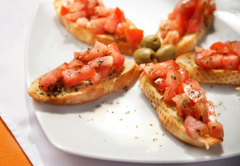 Fresh chopped tomato and basil on crostini