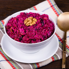Fresh salad with beet and walnuts