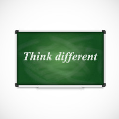 Think different. Text on a chalkboard.