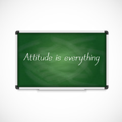 Attitude is Everything. Text on a chalkboard.