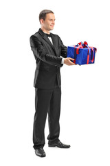 Young guy holding a wrapped present