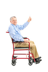 Senior man in wheelchair giving a thumb up