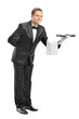 Professional waiter holding a tray