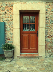 Door of stone wall house, Provence, France
