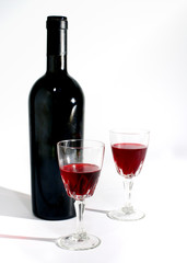 Wine glass and wine bottle still life isolated