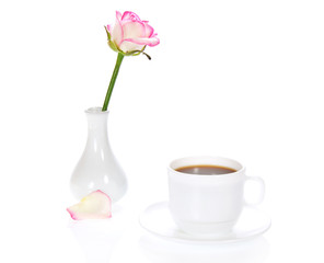 Vase with rose and cup