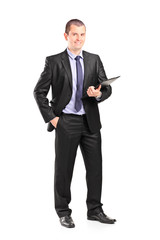 Cheerful businessman holding a clipboard