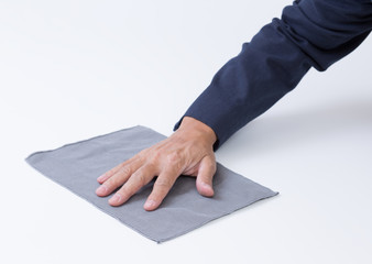 Man hand with rag cleaning the floor