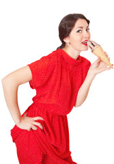 Pretty woman in red dress eating ice cream