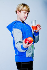 handsome boy with apple and juice