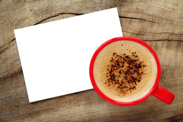 Cup of espresso with creamy foam and a white greeting card