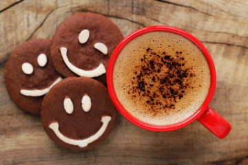 Good morning concept - cup of coffee with smiling cookies