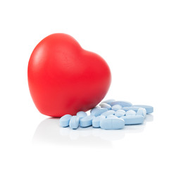 Pills next to red heart