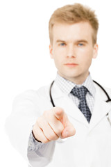 Doctor pointing on viewer with index finger of his right hand