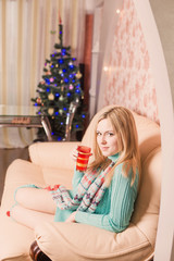 beautiful girl indoor  with Christmas tree