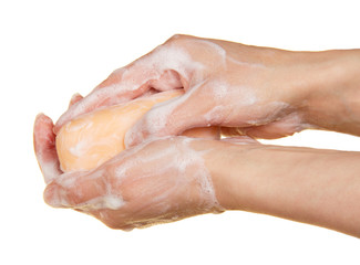 Piece of fragrant soap in the female hands
