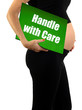 handle with care pregnancy concept
