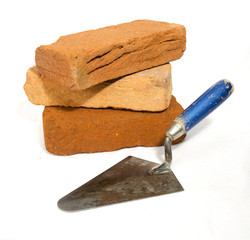 Three bricks with trowel
