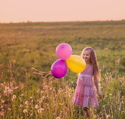 happy girl with pink balloon outdoor