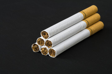 Cigarettes isolated on black background.