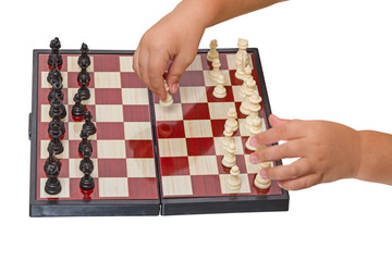 Child makes a move chess pawn