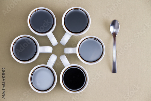 Decorative design of coffee mugs on beige