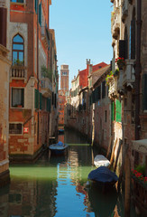 Narrow canal in Venice  , Italy.