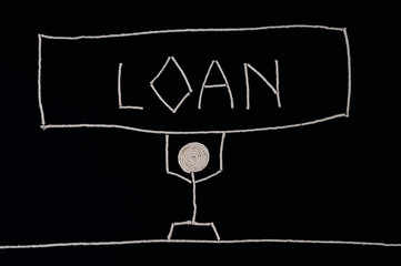 Man carrying the weight of a loan, unusual concept