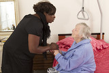 care giver holding senior's hands