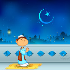 Kid offering namaaz for Eid celebration