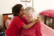grand son hugging and embracing grandmother  home hospitalized