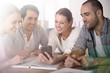 Group of business people in office using smartphone