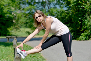 sporty young woman makes stretching exercises