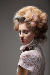 Individuality. Haute Couture. Swanky Woman with Colored Hair