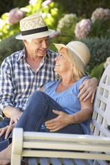 Romantic senior couple relaxing in garden