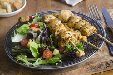 Chicken tikka skewers with salad