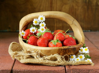 basket of fresh ripe strawberries - summer berries rustic style