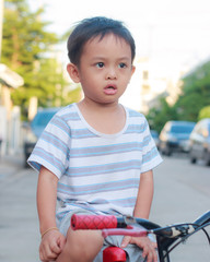 asian kid on bike