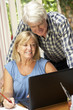 Senior Couple Working In Home Office