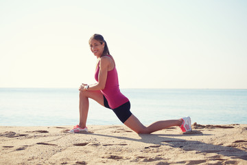 athletic girl with strong body doing stretching exercise